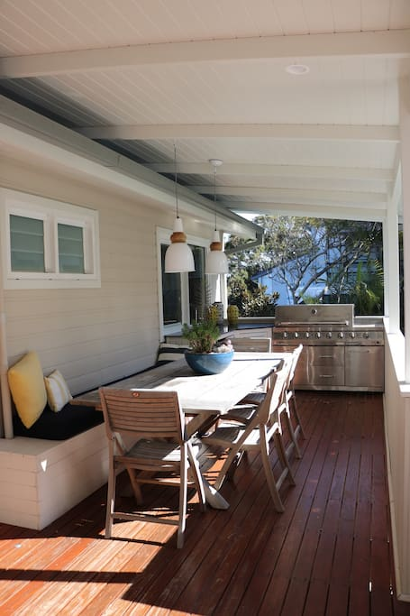 Back deck overlooking pool with built in kitchen