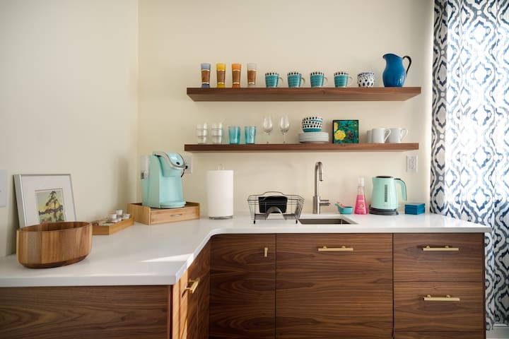 Funky kitchenette with coffee and tea stations.