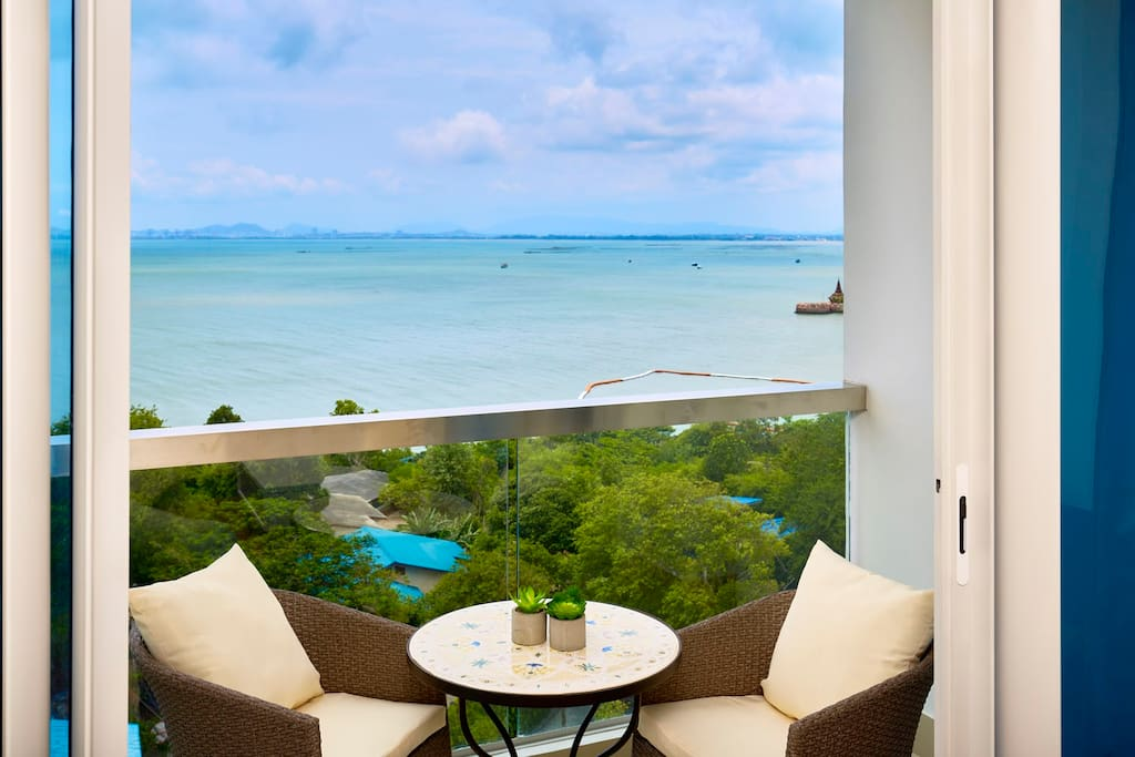 Dining table on balcony to enjoy the sea view with your partner.