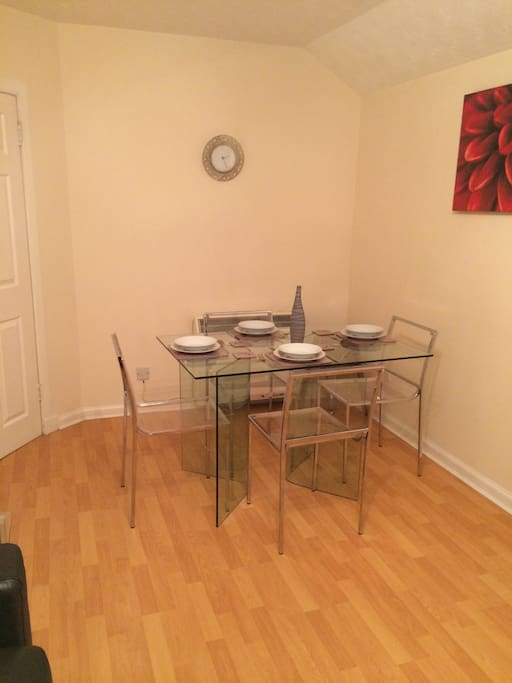 Dining area in the lounge with table and chairs