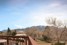 Gorgeous view from the deck of Grand Viewtopia! Cheyenne Mountain, Red Rock Canyon, and Pike's Peak!