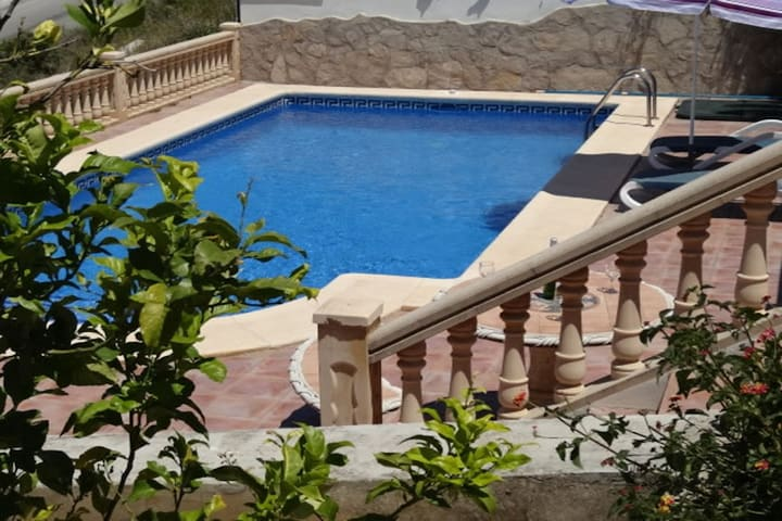 steps from the upper terrace to the pool area.
