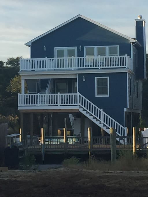 Back of house. Two balconies with views of lagoon. Dock for up to 40 foot boat