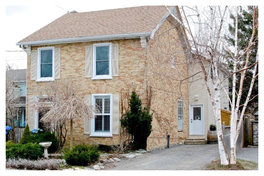 Yellow brick century home on quiet residential street, seconds away from Picton Main Street.
