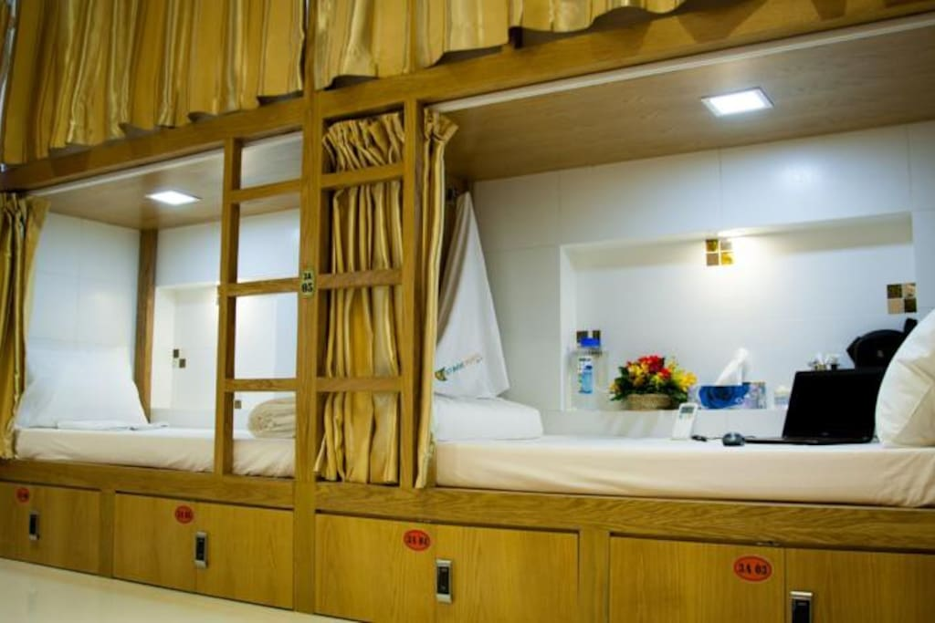 bunk bed with curtain, safe locker under the bed