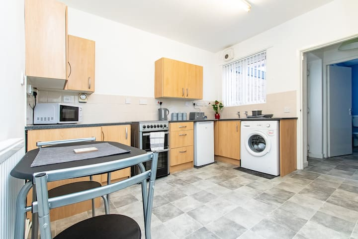 Large kitchen with washing machine and all the amenities you need to cook