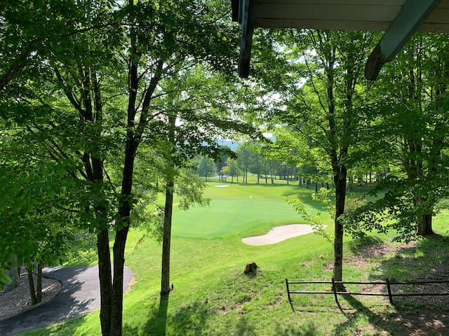 View from great room balcony overlooking golf course .