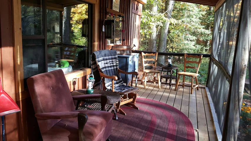 Screened porch overlooking pond and falls