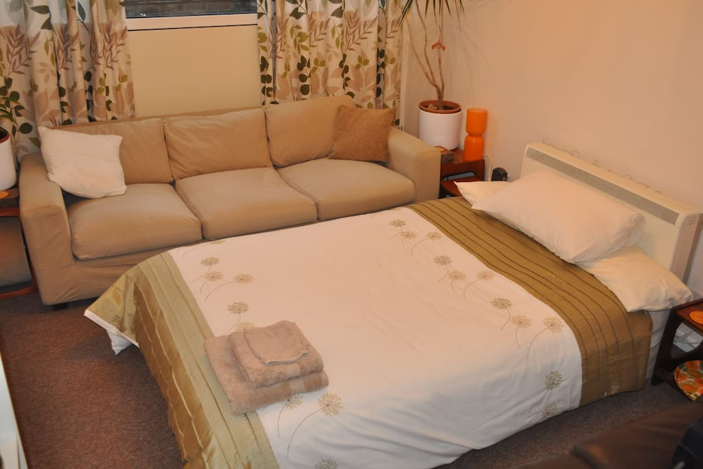 Aerial view of the bed and comfortable sofa for lounging.