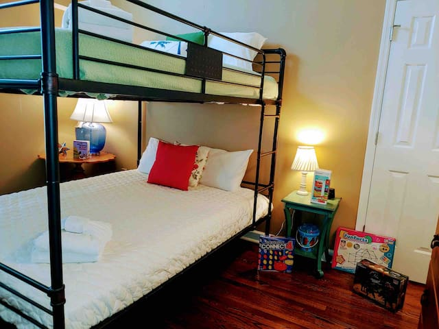 This bedroom has a bunk bed for TWO queen beds; there is a jack and Jill bathroom attached. Carolina Elegance North has toys, games and books for all ages. Guests bring a toy for their children to play with and then leave it behind for future kids.