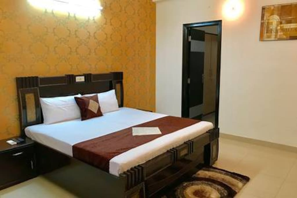 Designer Bed with premium mattress and attached bathroom plus TV with Tata Sky HD