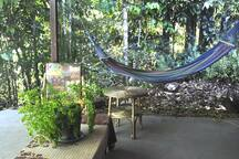 Chillax in the hammock right next to the rainforest