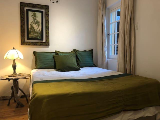 Wadi Bedroom with a double bed and en-suite bathroom.