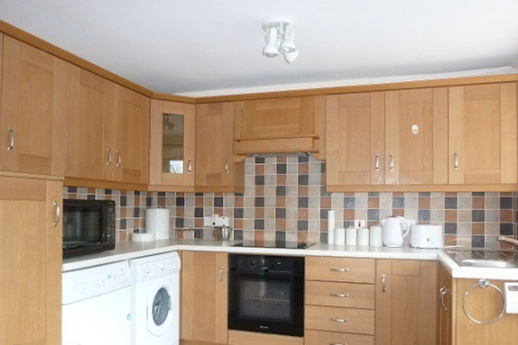 Fully equipped Kitchen- oven, hob, microwave, washing machine, tumble dryer, all cooking utensils, cutlery and crockery supplied.
