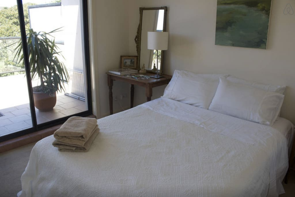 Comfortable Queen sized bed overlooking large balcony