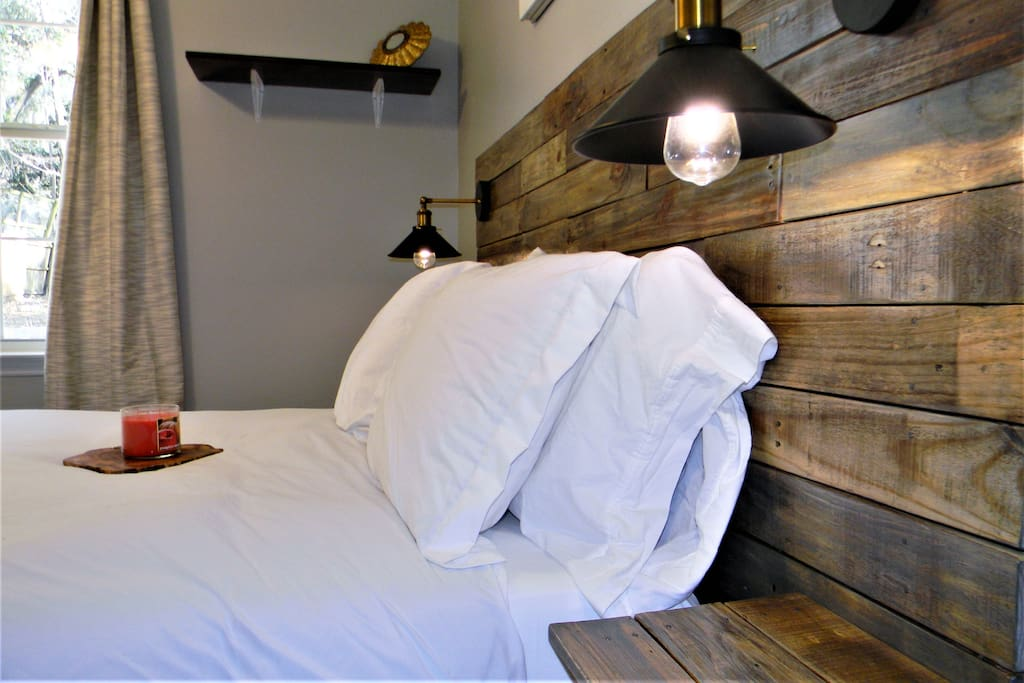Rest peacefully in your reclaimed hardwood queen bed with memory foam mattress