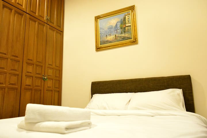 Bedroom with queen size bed, aircond and bathroom with hot shower.