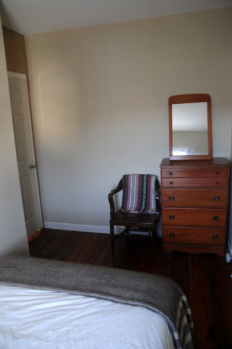 Room includes a dresser to store your belongings for longer stays.