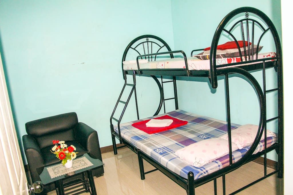 Second AC bedroom has double deck with queen size and single bed with blankets/towels including side corner table...