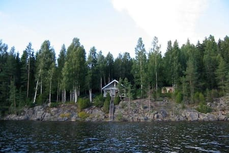 Finnish cabin with sauna and shower next to lake
