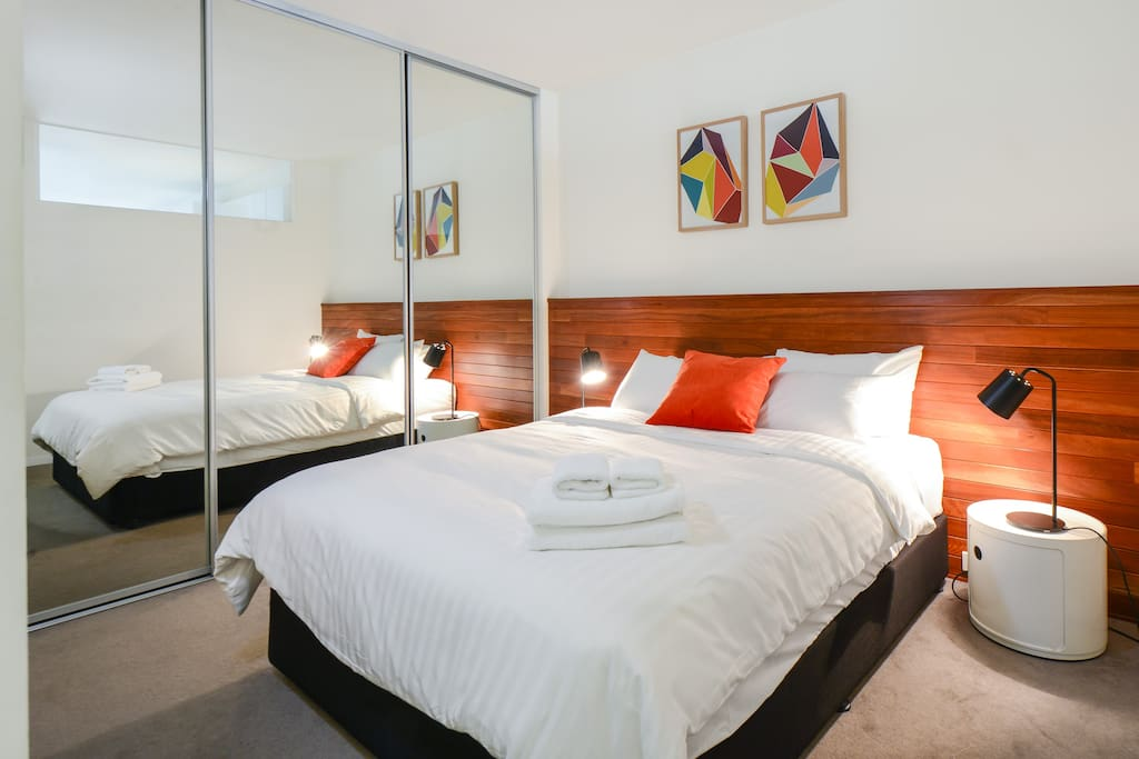 Queen bed with chiropedic mattress and freshly prepared linens prior to every guest's arrival