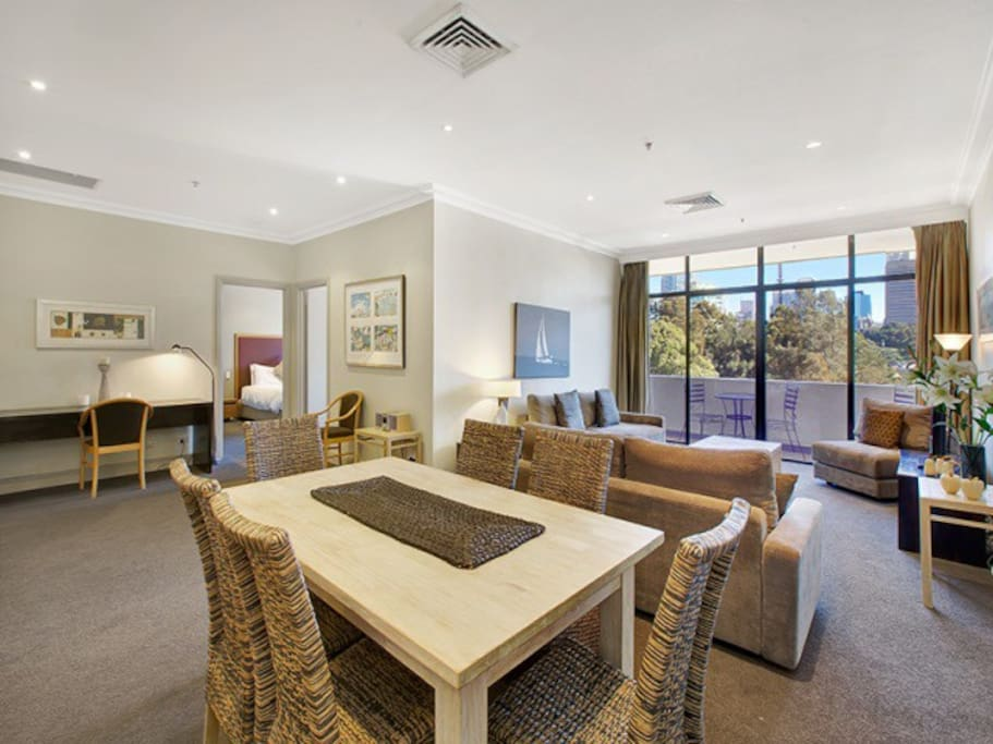 Spacious dining/living area with flat screen, plasma TV, cable TV, sound system and workstation desk