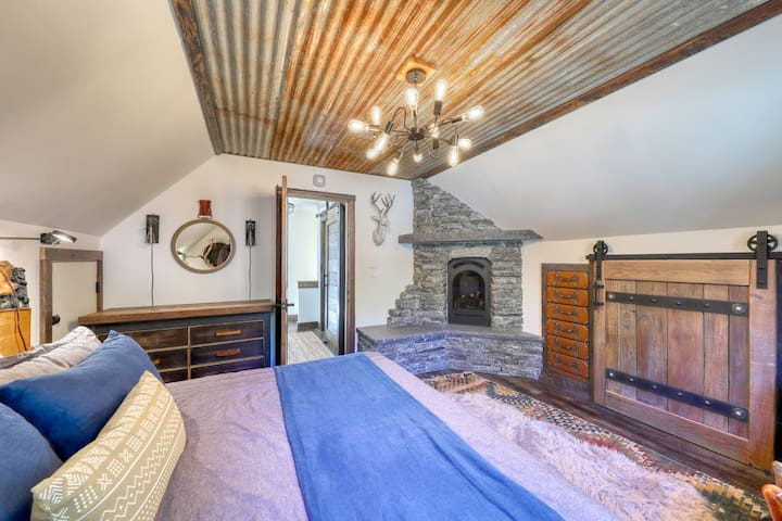 Master Bedroom: King Mattress, romantic gas fireplace, built in leather drawers, large closet, handmade doors and furniture.