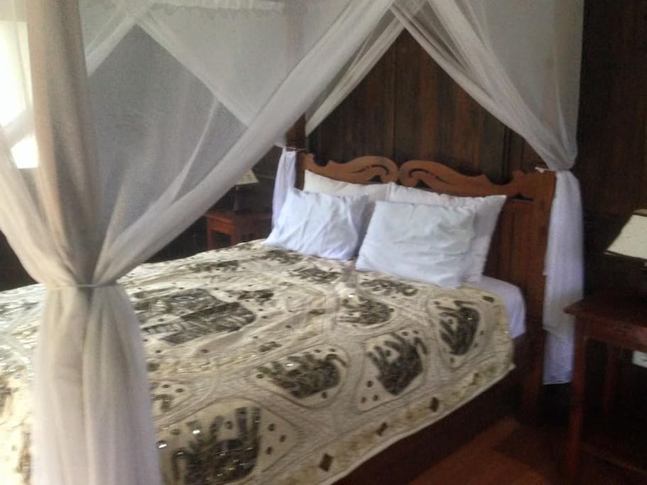 Double bed with Mosquitos net