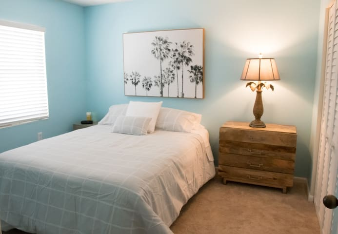 Guest Bedroom with streaming TV on the wall