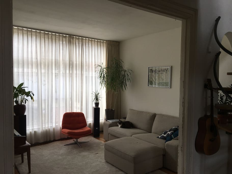 This is the living room, with a lounge sofa. Upstairs there is an other sofa, where you can watch television and Netflix.