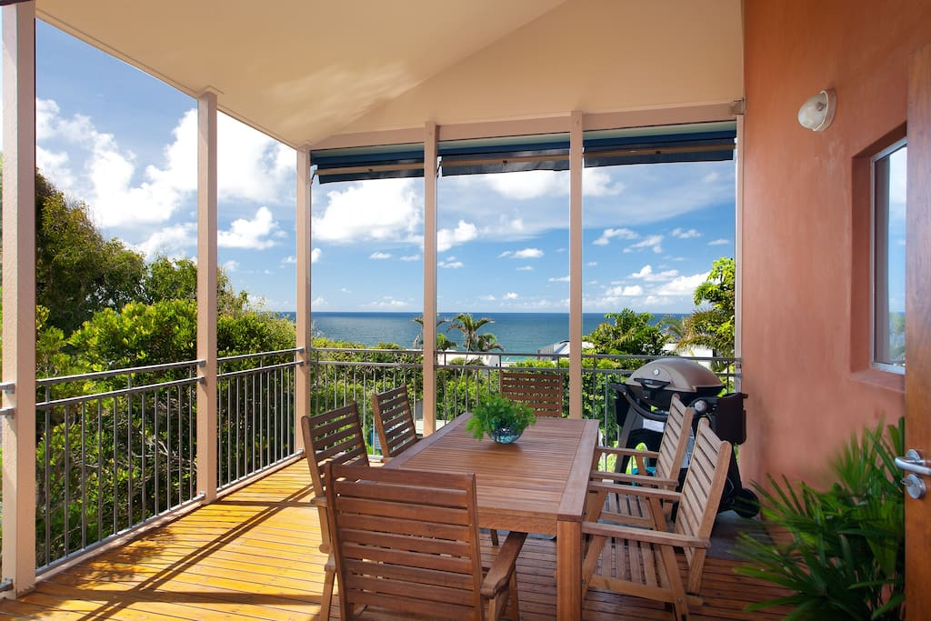 Furnished deck with ocean view. great place to BBQ.