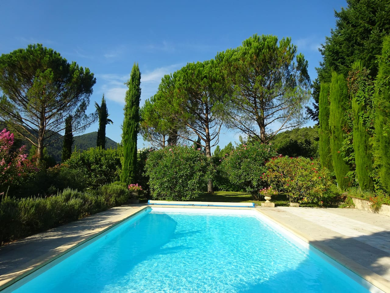 The swimming pool and its view onto the Cévennes d'Ardèche in May