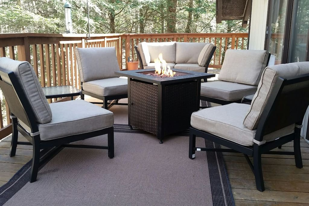 New outdoor cushioned furniture and propane firepit!