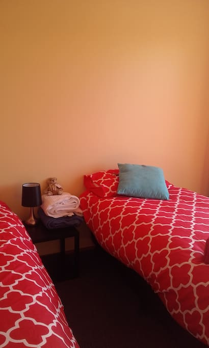 2 cosy single beds, can easily be moved together to make a queen size bed