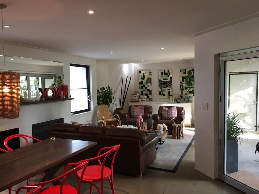 Open plan living, dining and kitchen with large opening doors onto tranquil and lush courtyard.