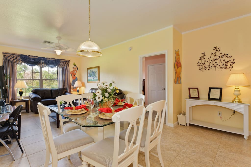 Tastefully decorated living & dining area  looking into lovely conservation area