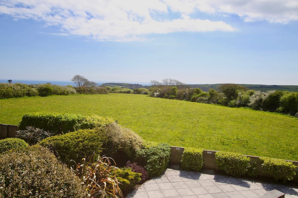The view from the cottage across fields to the sea!