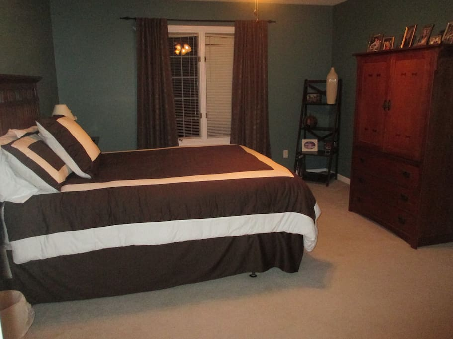 Bedroom 1 has a queen bed and private bathroom and is located upstairs. Ample size room with reading area.