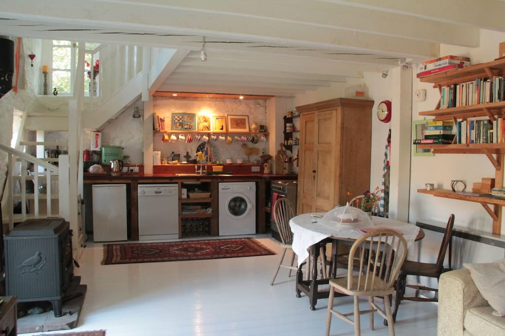 A well equipped kitchen at the end of the open plan living space.