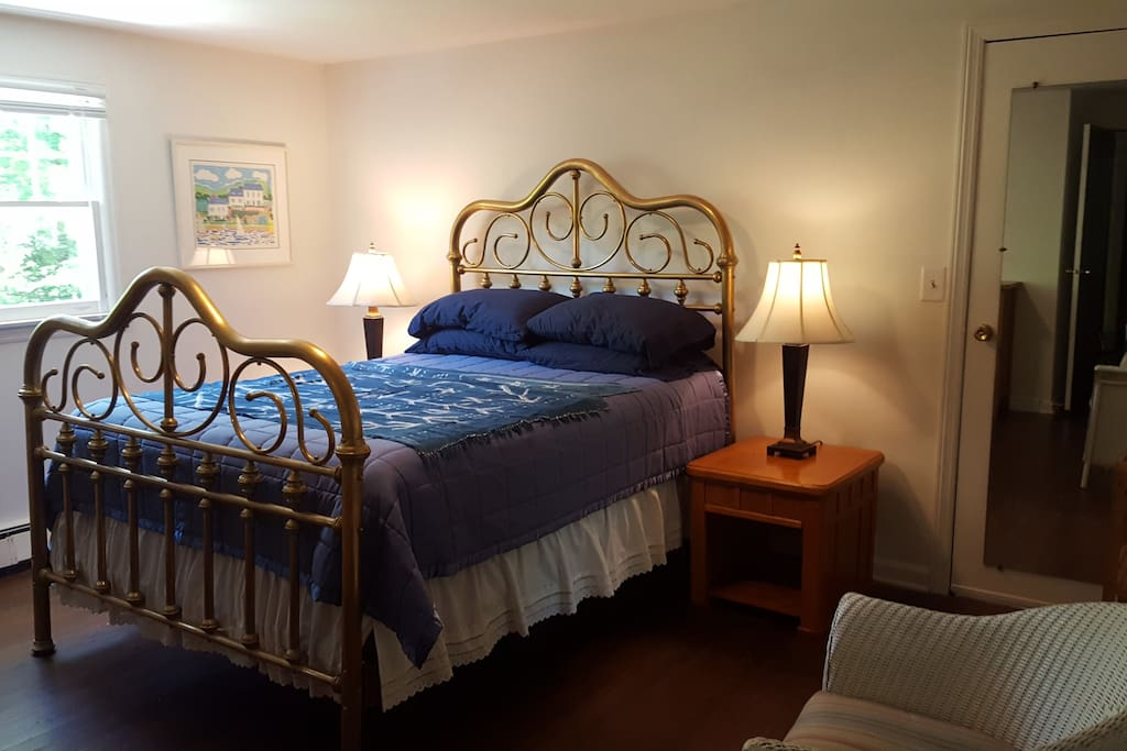 Master brass queen bed with private bath and large closet space