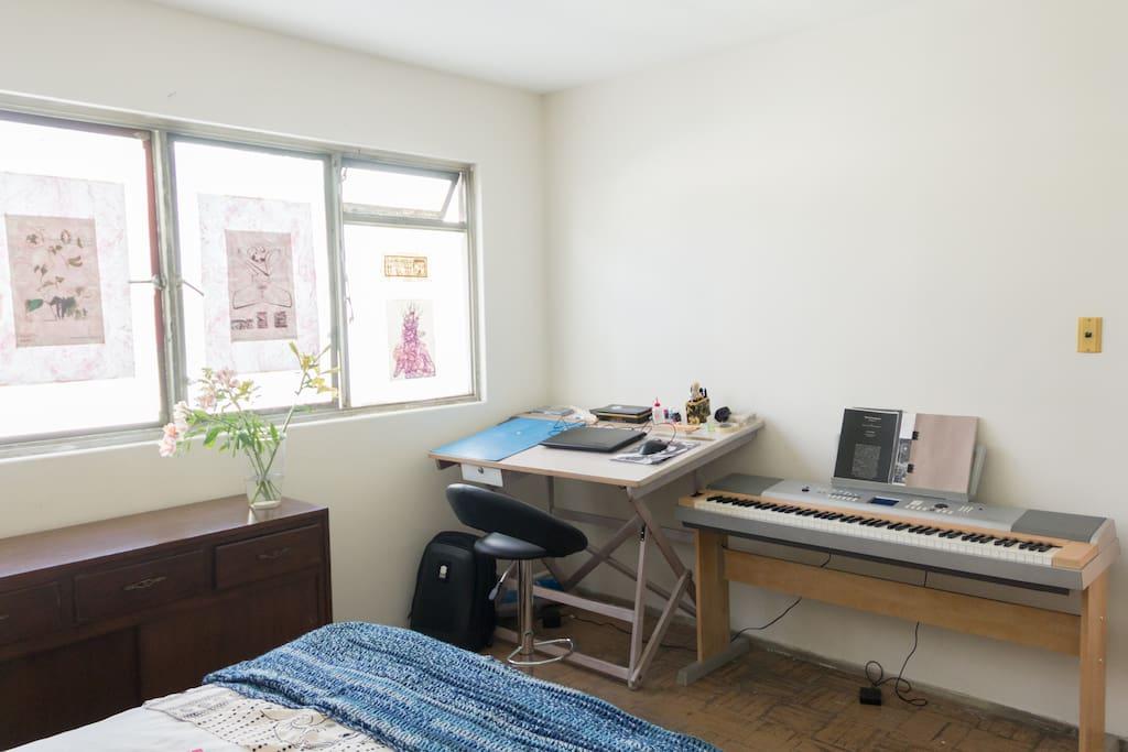 Yamaha Keyboard and white draft table