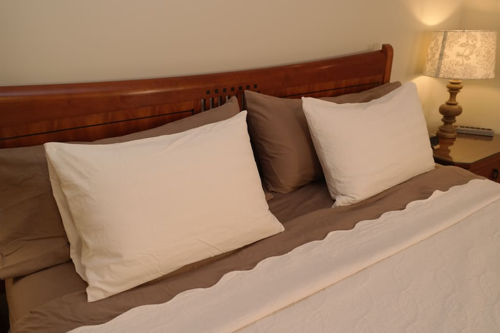Four pillows are provided on the King Bed.