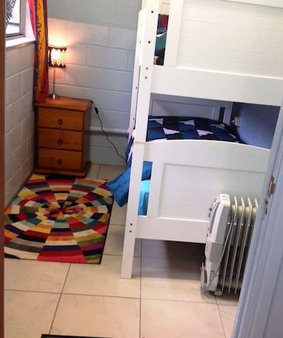 Bedroom 3:  2 single bunk beds, accessed from verandah