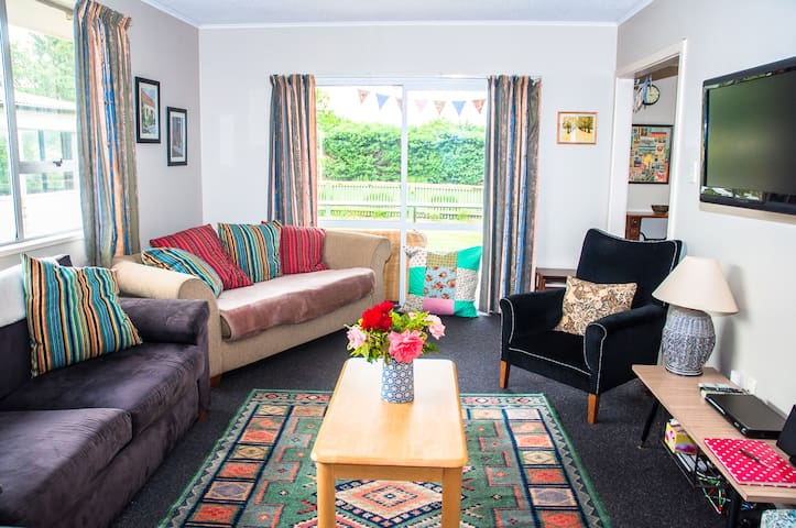 Spacious living room, large windows and ranch sliding door provide all day sun, TV , DVD, music docker, quality sprung bed settee, gives extra sleeping option.