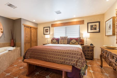 The guest bedroom has a king bed, armoire, iPod dock and spacious two-person jetted tub.
