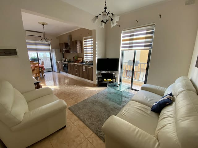 Combined Kitchen, Dining and Living area + two balconies. Relax in modern environment with the apartment being all day blessed with natural light.
