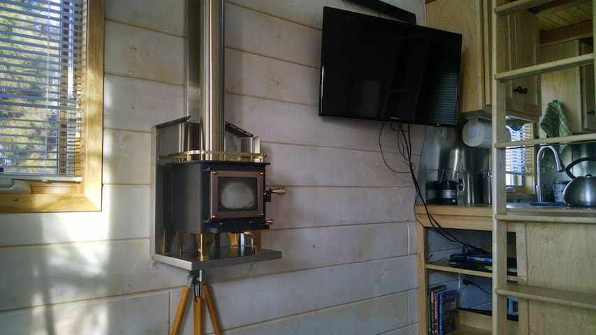 """Our """"Cubic Mini Wood Stove"""" is just big enough to heat the whole house. There is a TV to watch movies."""