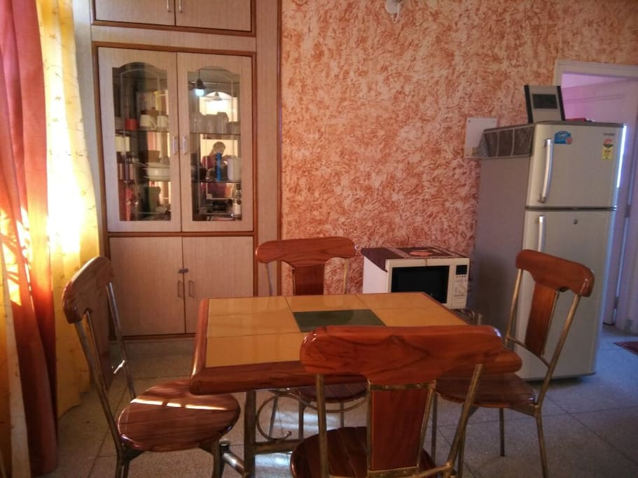 Dining area with microwave and refrigrator.