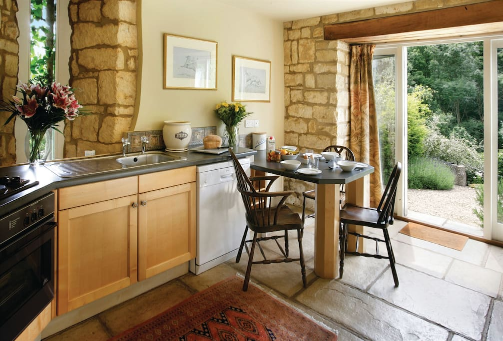 Ground floor: Kitchen which opens to dining room and sitting room
