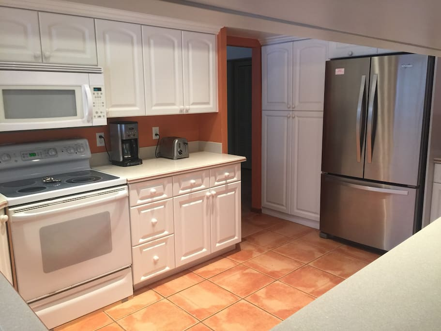 Nicely appointed kitchen with pass through window to back patio